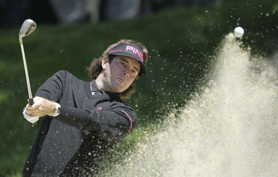 Bubba Watson hits out of a bunker on the second hole during the second round of the U.S. Open Championship golf tournament Friday. Watson did not make the cut, but will soon make his way to Connecticut to take part in the 2012 Travelers Championship in Cromwell.