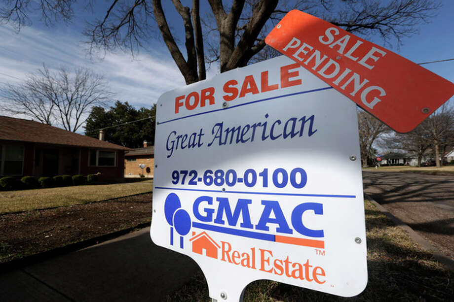 In this Friday, Feb. 22, 2013, photo, a sale pending announcement sits atop a for sale sign in a home's yard in Richardson, Texas. Fewer Americans signed contracts to buy homes in February, but the level stayed close to a nearly three-year high. The report suggests sales of previously occupied homes will keep rising in the coming months. (AP Photo/LM Otero) / AP