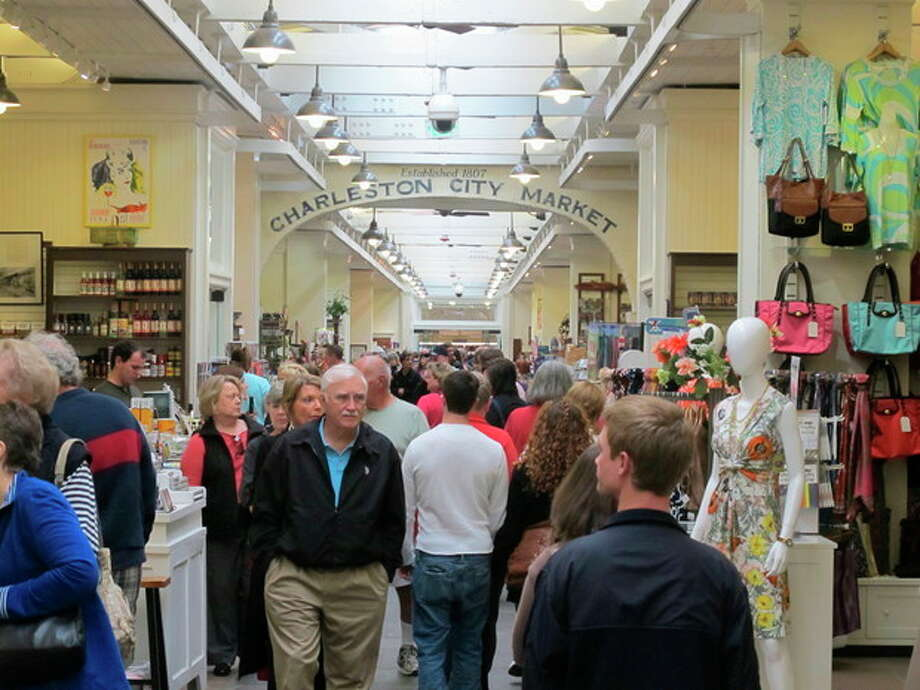 AP Photo/Bruce SmithVisitors crowd the popular City Market in in Charleston, S.C. on March 11. The Market has vendors selling everything from T-shirts and jewelry to paintings and pocketbooks but it's free to wander through and is a great place to people watch. / AP