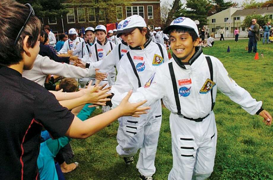 Rithwik Shivram, Specialist with Columbus Magnet School''s Young Astronaut, program is greeted by the student body as the astronauts are introduced at the program''s payload launch event -- Hour photo / Erik Trautmann