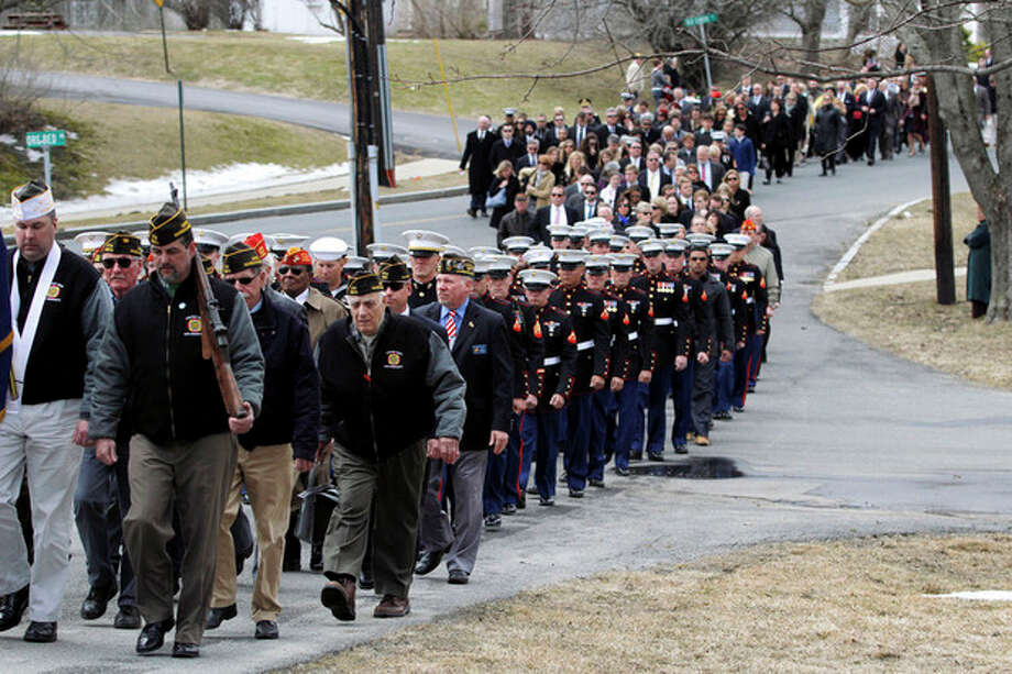 AP photoMarines, veterans, and more then 1,000 mourners form the funeral procession for Lance Cpl. Roger Muchnick Jr. outside St. Ann's Parish in Lenox, Mass. on Friday. Muchnick was one of seven Marines killed on March 18 when a mortar shell exploded in its firing tube during an exercise at Hawthorne Army Depot in Nevada. He was 23. The accident remains under investigation. Muchnick grew up in Westport. / The Berkshire Eagle