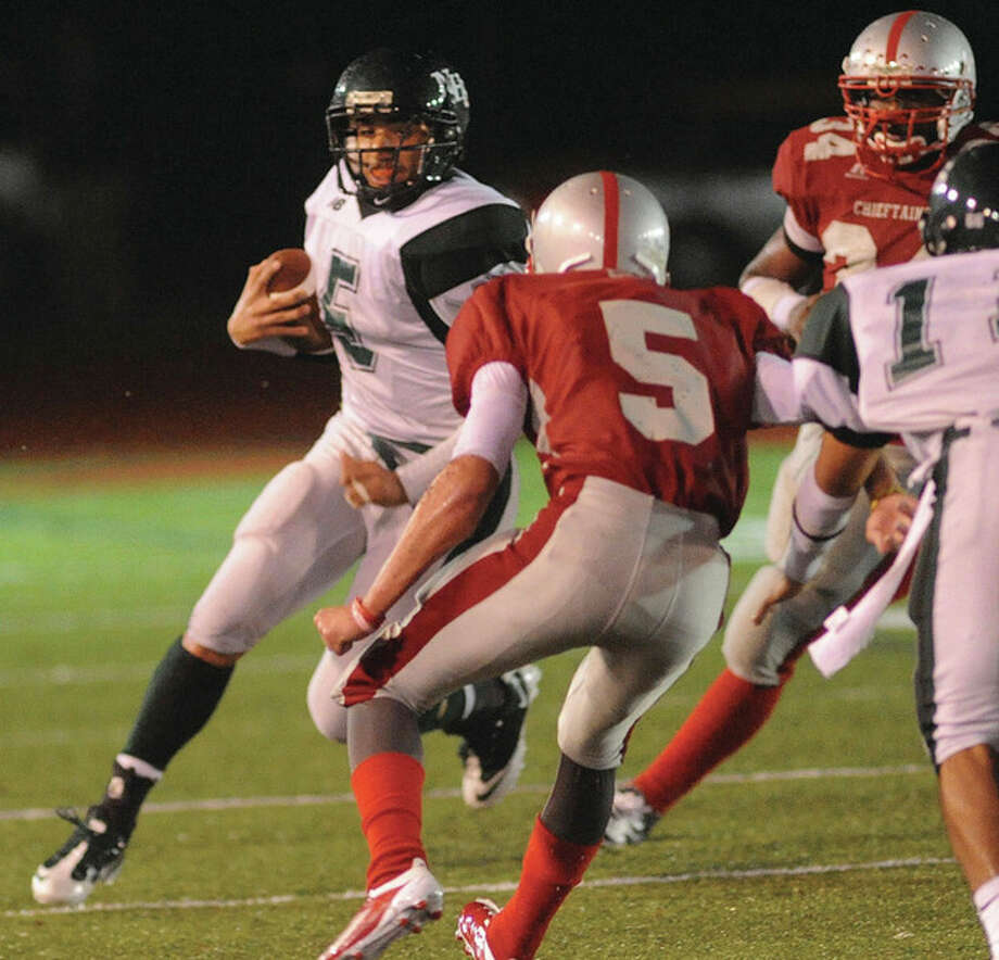 Hour photo/John Nash Norwalk quarterback Delshawn Wilson, left, looks for running room during Tuesday's 21-15 victory over Conard. That victory earned the Bears a shot at Xavier, the top seed in Class LL. The two teams square off today at West Haven's Ken Strong Stadium.