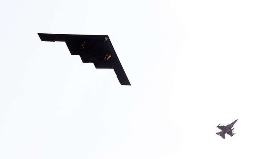 U.S. Air Force B-2 stealth bomber, left, flies over near Osan U.S. Air Base in Pyeongtaek, south of Seoul, South Korea, Thursday, March 28, 2013. A day after shutting down a key military hotline, Pyongyang instead used indirect communications with Seoul to allow South Koreans to cross the heavily armed border and work at a factory complex that is the last major symbol of inter-Korean cooperation. (AP Photo/Lee Jung-hun, Yonhap) KOREA OUT / YONHAP