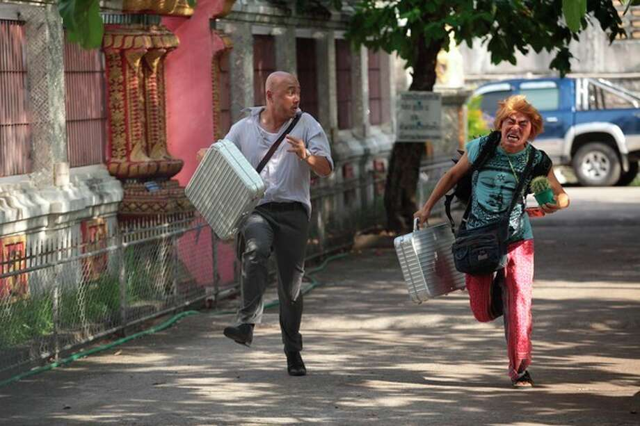 "In this publicity image released by Pegasus Motion Pictures, Xu Zheng, left, and Wang Baoqiang run in a scene from ""Lost in Thailand."" Xu, the director, writer and star of China's biggest box-office hit, says ""Lost in Thailand"" succeeded by showing a rarely seen subject: modern Chinese life. The historical epic, fantasy, action and thriller genres have long filled China's domestic movie screens. But ""Lost in Thailand"" was a low-budget and light-hearted road-trip tale about an ambitious executive who goes to Thailand to get his boss' approval for a business deal. Along the way he's pursued by a rival co-worker and encounters a wacky tourist who helps him rethink his priorities. (AP Photo/Pegasus Motion Pictures) / Pegasus Motion Pictures"