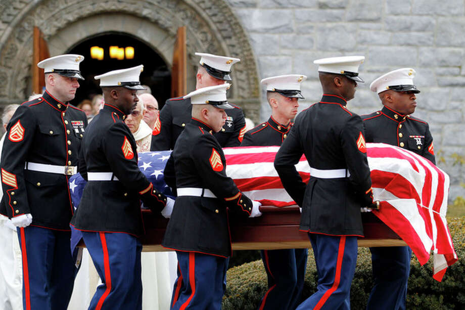 Marines carry the coffin of Lance Cpl. Roger Muchnick Jr. after funeral services at St. Ann's Parish in Lenox, Mass. on Friday, March 29, 2013. Muchnick was one of seven Marines killed on March 18 when a mortar shell exploded in its firing tube during an exercise at Hawthorne Army Depot in Nevada. He was 23. The accident remains under investigation. Muchnick grew up in Westport, Conn (AP Photo/The Berkshire Eagle, Stephanie Zollshan) / The Berkshire Eagle