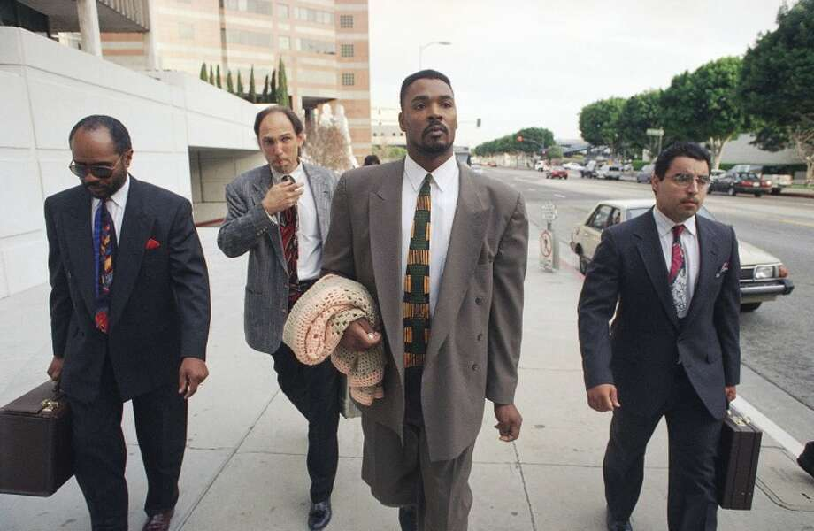 FILE - This March 23, 1994 file photo shows Rodney King, second from right, leaving the Federal Courthouse in Los Angeles with his lawyer Wilton Grimes, far left, and two unidentified men. King, the black motorist whose 1991 videotaped beating by Los Angeles police officers was the touchstone for one of the most destructive race riots in the nation's history, has died, his publicist said Sunday, June 17, 2012. He was 47. (AP Photo/Chris Pizzello, file)