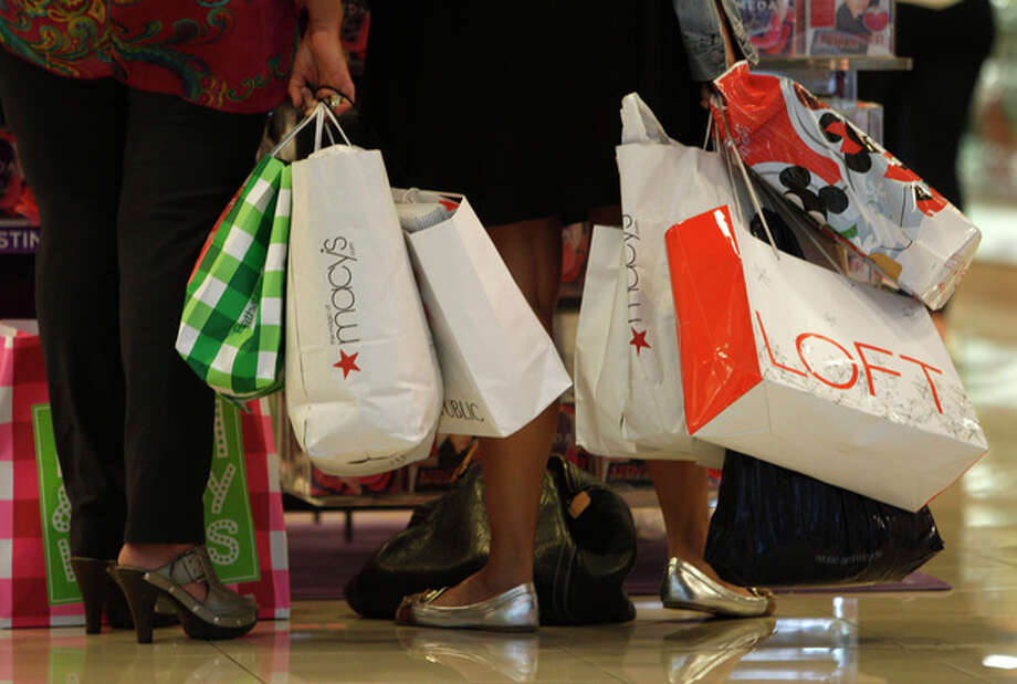 FILE - In this Nov. 25, 2011 file photo, shoppers stop to look at a display while shopping at Dadeland Mall, in Miami. Americans spent more on autos, furniture and clothing last month as retail sales rose for the sixth straight month. (AP Photo/ Lynne Sladky) / AP