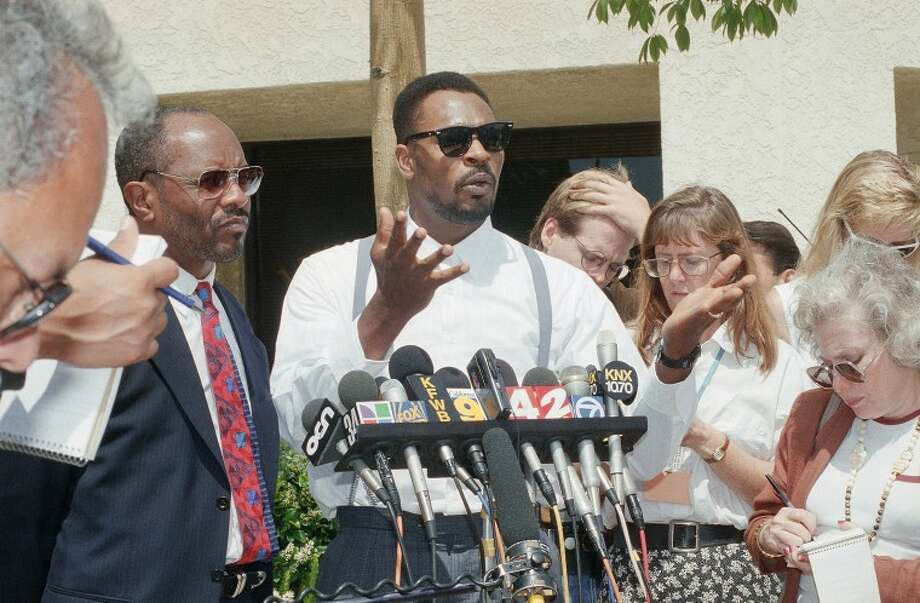 FILE - This June 2, 1994 file photo shows Rodney King speaking at a news conference in Santa Ana, Calif. along with his attorney Milton Grimes, at left. King, the black motorist whose 1991 videotaped beating by Los Angeles police officers was the touchstone for one of the most destructive race riots in the nation's history, has died, his publicist said Sunday, June 17, 2012. He was 47. (AP Photo/Chris Martinez, file)
