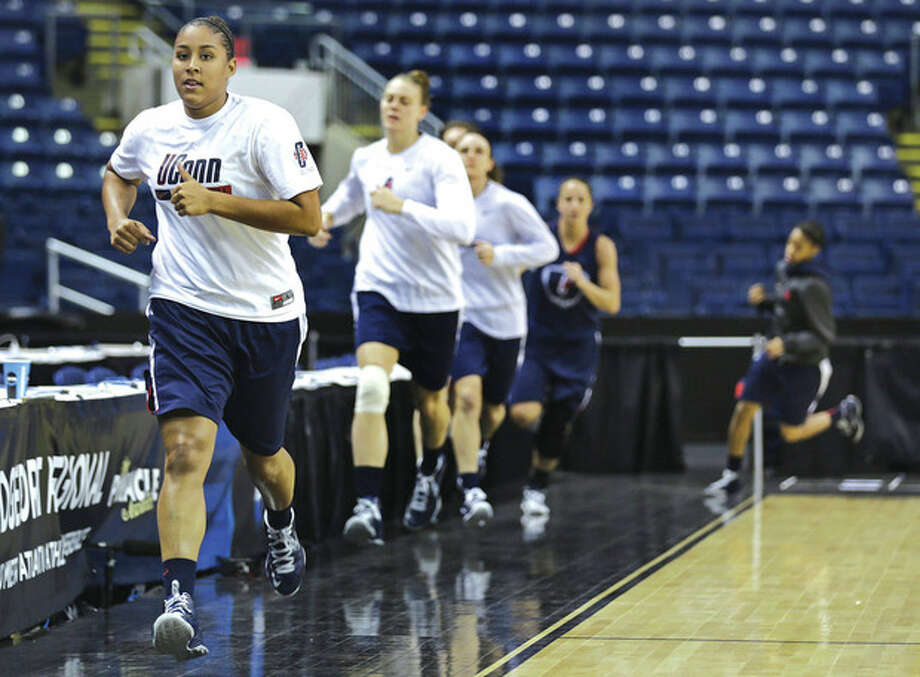 AP photoKaleena Mosqueda-Lewis, left, leads the way as UConn runs laps around the court at Bridgeport's Webster Bank Arena during Friday's practice for the regional semifinal game against Maryland. The Huskies and the Terps are scheduled to clash at 2:30 p.m. Saturday with a spot in the NCAA's Elite Eight at stake. / AP