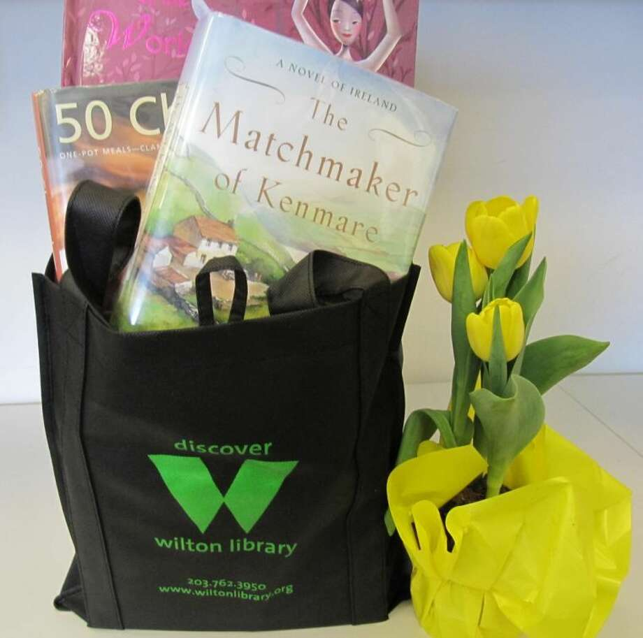 "Wilton Library celebrates ""Our Community Matters @ Wilton Library,"" part of National Library Week, April 14 through 20 with programs, new technology and services demonstrations and a Downton Abbey marathon and tea social. Pictured: the new Wilton Library logo shopping bag given free on Friday, April 19 for customers who borrow 10 or more items. Wilton Library, 137 Old Ridgefield Road, Wilton, CT. For information, visit www.wiltonlibrary.org or call 203-762-3950, ext. 213."