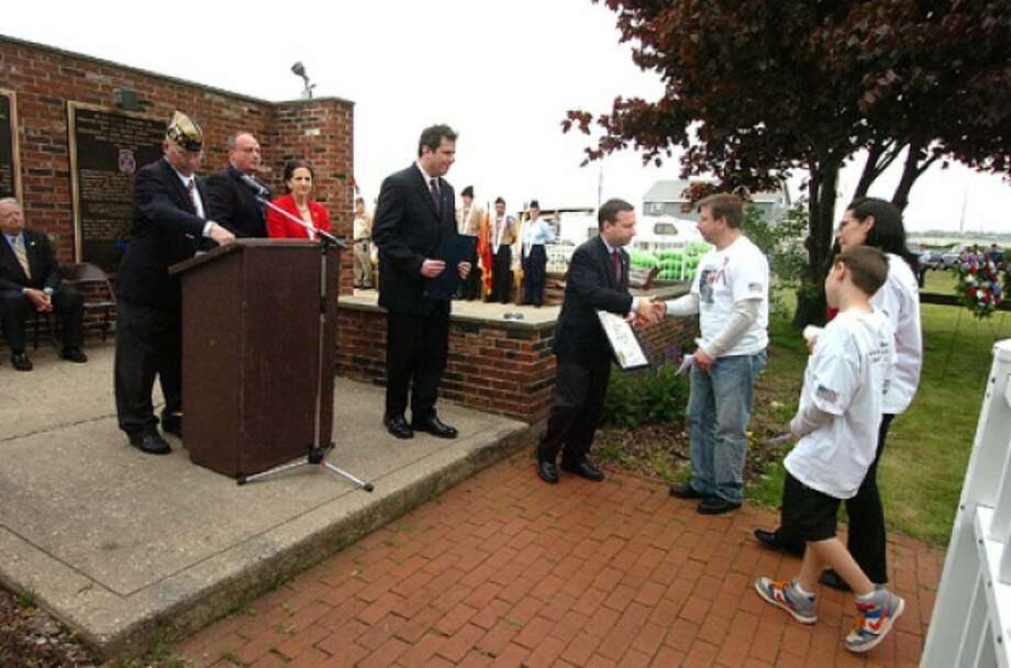 Photo/Alex von Kleydorff. Sen. Bob duff presents a proclamation to members of SPC David Fahey Jr.