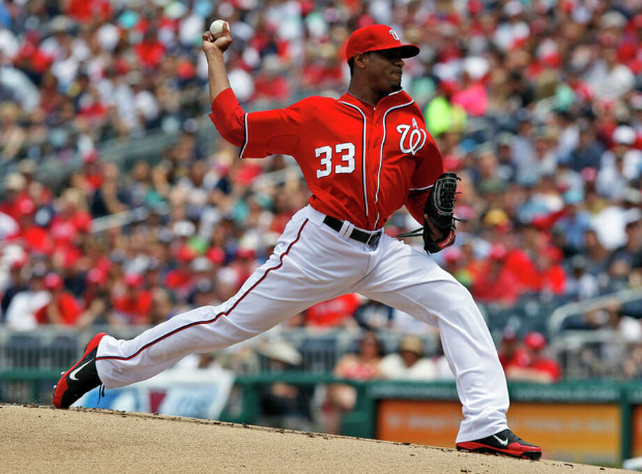 Washington Nationals starting pitcher Edwin Jackson throws during the first inning of a baseball game with the New York Yankees at Nationals Park, Sunday, June 17, 2012, in Washington. (AP Photo/Alex Brandon) / AP