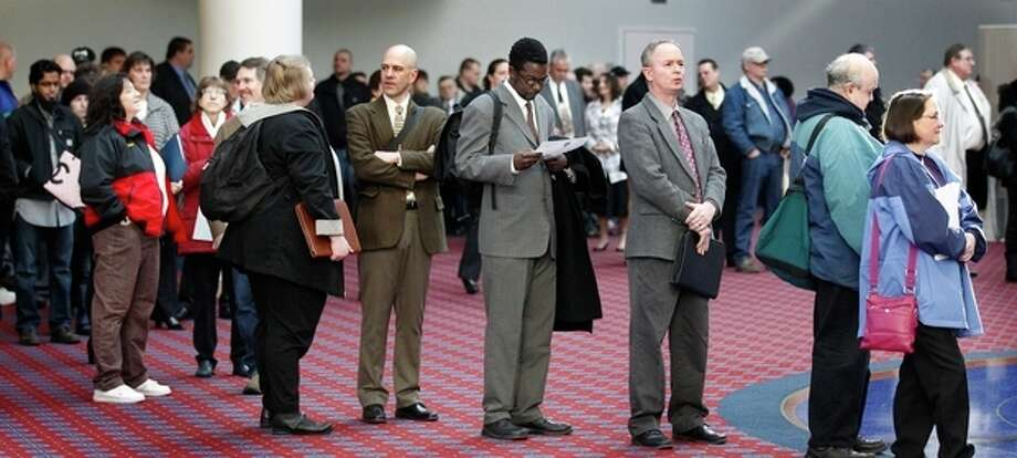 FILE - In this March 7, 2012, file photo shows job seekers standing line during the Career Expo job fair, in Portland, Ore. Employers pulled back sharply on hiring last month, a reminder that the U.S. economy may not be growing fast enough to sustain robust job growth. The unemployment rate dipped, but mostly because more Americans stopped looking for work. The Labor Department says the economy added 120,000 jobs in March, down from more than 200,000 in each of the previous three months. (AP Photo/Rick Bowmer) / AP2012
