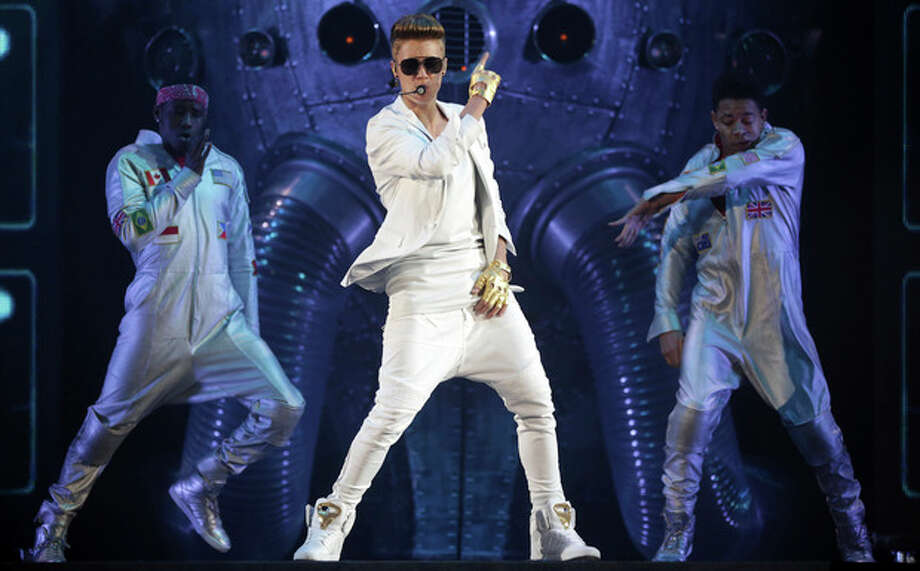"FILE - In this March 28, 2013 file picture Canadian singer Justin Bieber performs on stage during the ""I Believe Tour "" in Munich, southern Germany. A German official says Justin Bieber had to leave a monkey in quarantine after arriving in the country last week without the necessary papers for the animal. The 19-year-old singer arrived at Munich airport last Thursday. Customs spokesman Thomas Meister said Saturday March 30, 2013 that when he went through customs he didn't have the documentation necessary to bring the capuchin monkey into the country - so the animal had to stay with authorities. (AP Photo/Matthias Schrader,File) / AP"