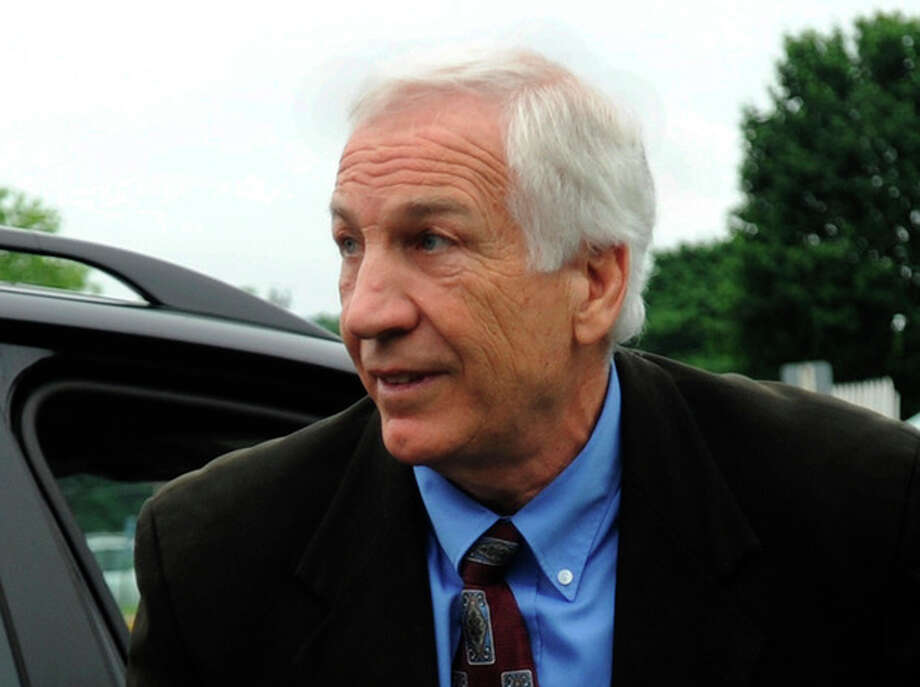 Jerry Sandusky arrives the courthouse for the second week of his trial at the Centre County Courthouse, in Bellefonte, Pa., Monday, June 18, 2012. The defense is to begin presenting it's case in Sandusky's trial on 52 counts of child sexual abuse involving 10 boys over a period of 15 years on Monday. (AP Photo/Centre Daily Times, Nabil K. Mark) / Centre Daily Times