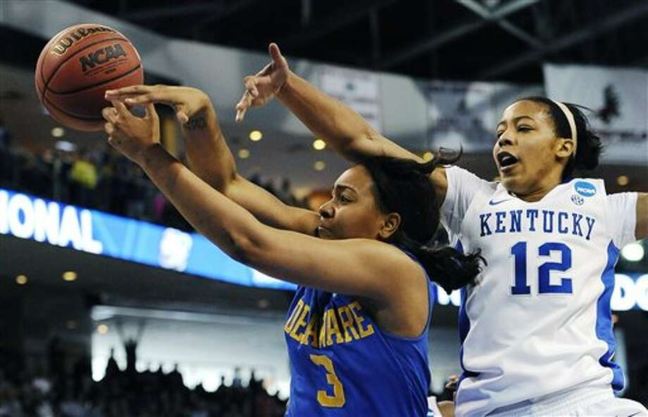 Delaware guard Jaquetta May (3) tries to grab a rebound against Kentucky's Jelleah Sidney (12) during the first half of a regional semifinal in the women's NCAA college basketball tournament in Bridgeport, Conn., Saturday, March 30, 2013. (AP Photo/Jessica Hill) / AP