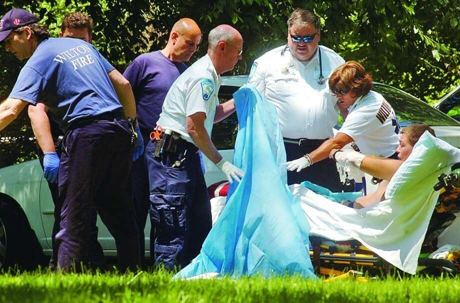 A young man was burned on his arms and legs Friday on Huckleberry Rd in Wilton. Hour photo / Erik Trautmann