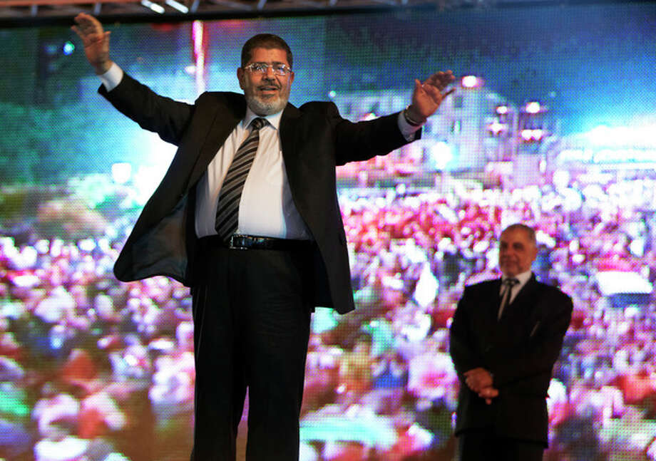 FILE - In this Sunday, May 20, 2012 file photo, the Muslim Brotherhood's presidential candidate Mohammed Morsi holds a rally in Cairo, Egypt. The Muslim Brotherhood has declared that its candidate, Mohammed Morsi, won Egypt's presidential election, early Monday, June 18, 2012.(AP Photo/Fredrik Persson, File) / AP