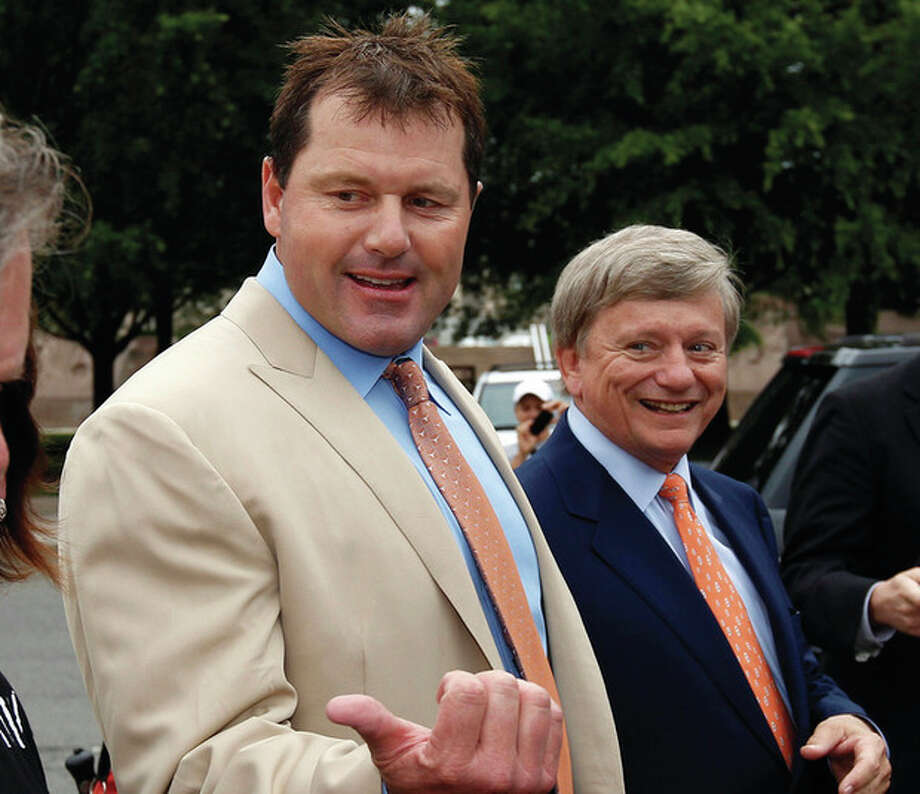 AP photo / Alex BrandonFormer Major League Baseball pitcher Roger Clemens, left, with his attorney Rusty Hardin, arrives at federal court Monday. Clemens has been acquitted on all charges by a jury that decided he didn't lie to Congress when he denied using performance-enhancing drugs. / AP
