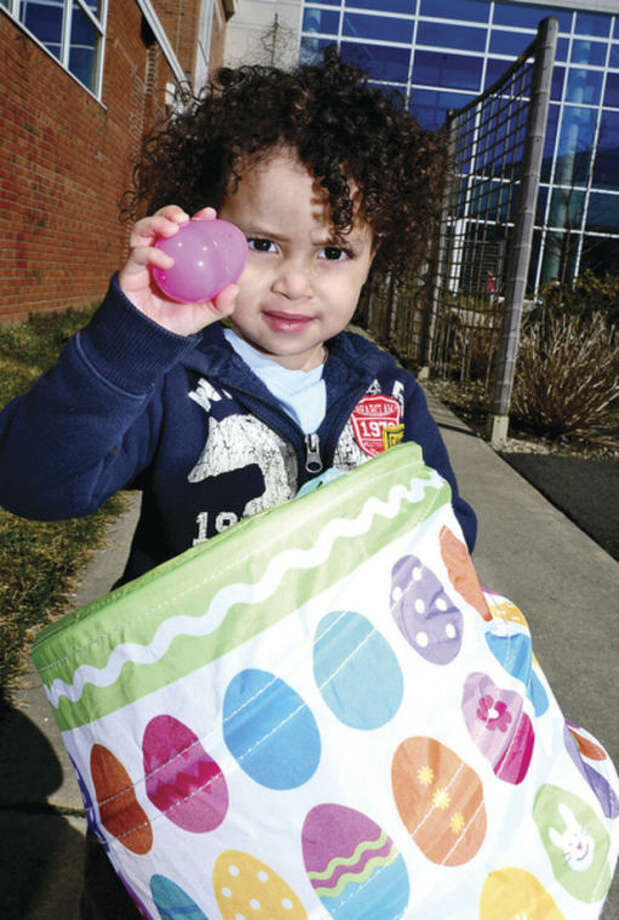 Taem Kaplan, 2, displays an egg he hunted at the Brien McMahon High School girls' soccer team Pancake Breakfast Fundraiser and Easter Egg Hunt Saturday at the Center for Global Studies. Hour photo / Erik Trautmann