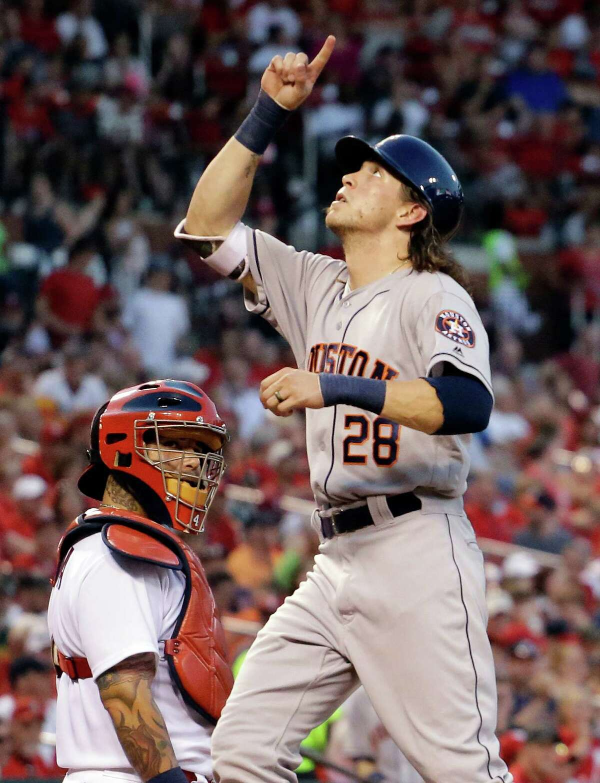 June 14: Astros 5, Cardinals 2 Houston Astros' Colby Rasmus celebrates after hitting a solo home run, next to St. Louis Cardinals catcher Yadier Molina during the fifth inning of a baseball game Tuesday, June 14, 2016, in St. Louis. (AP Photo/Jeff Roberson)