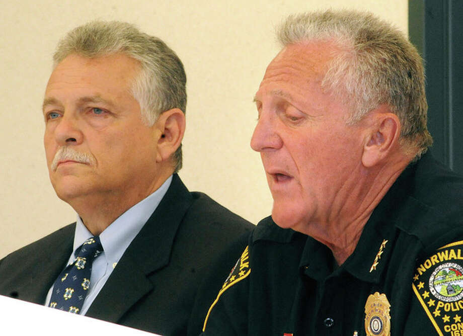 Hour photo / Matthew VinciNorwalk Police Chief Harry Rilling, right, appears with Police Commissioner Pete Toranno at police headquarters Monday. His future plans were discussed.