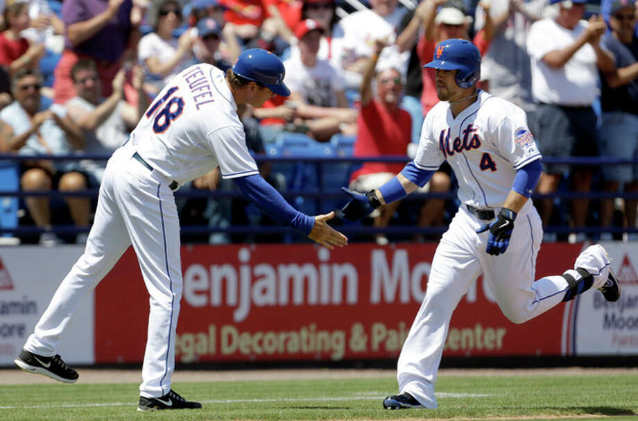 New York Mets' Collin Cowgill, right, is congratulated by third base coach Tim Teufel while rounding the bases after hitting a two-run home run during the fourth inning of an exhibition spring training baseball game against the St. Louis Cardinals, Friday, March 29, 2013, in Port St. Lucie, Fla. (AP Photo/Jeff Roberson) / AP