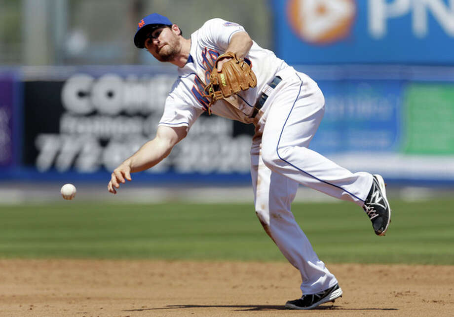 New York Mets second baseman Daniel Murphy throws St. Louis Cardinals' Matt Carpenter out at first during the fifth inning of an exhibition spring training baseball game Friday, March 29, 2013, in Port St. Lucie, Fla. (AP Photo/Jeff Roberson) / AP