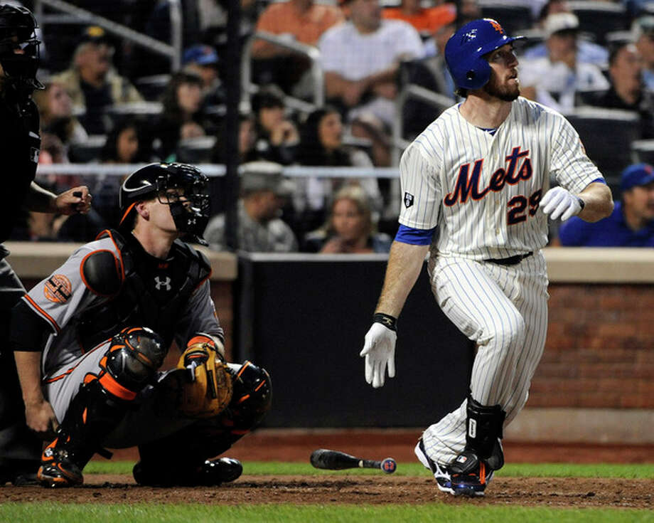 New York Mets' Ike Davis follows through on his grand slam as Baltimore Orioles catcher Matt Wieters, left, looks on during the sixth inning of an interleague baseball game, Monday, June 18, 2012, at Citi Field in New York. (AP Photo/Bill Kostroun) / FR51951 AP