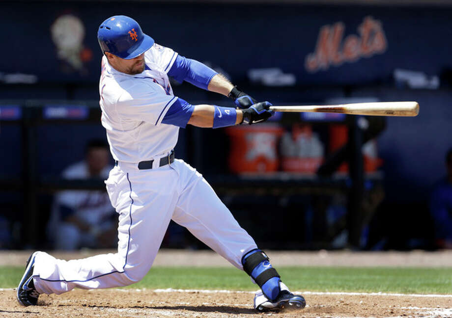 New York Mets' Collin Cowgill hits a two-run home run during the fourth inning of an exhibition spring training baseball game against the St. Louis Cardinals, Friday, March 29, 2013, in Port St. Lucie, Fla. (AP Photo/Jeff Roberson) / AP