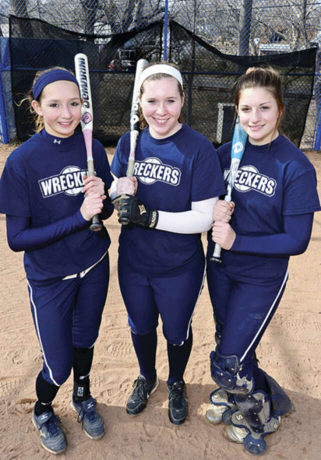 Hour photo/Erik TrautmannStaples softball team captains, from left, Nikki Bukovsky, Shannon Connors and Maggie Mills will lead the Wreckers into the season, which starts Wednesday.