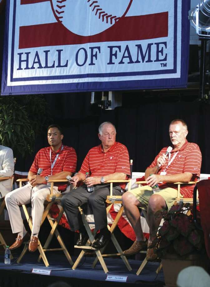 AP photo Roberto Alomar, left, Pat Gillick, center, and Bert Blyleven answer questions during a news conference Saturday in Cooperstown, N.Y. The three will be inducted into the Baseball Hall of Fame this afternoon.
