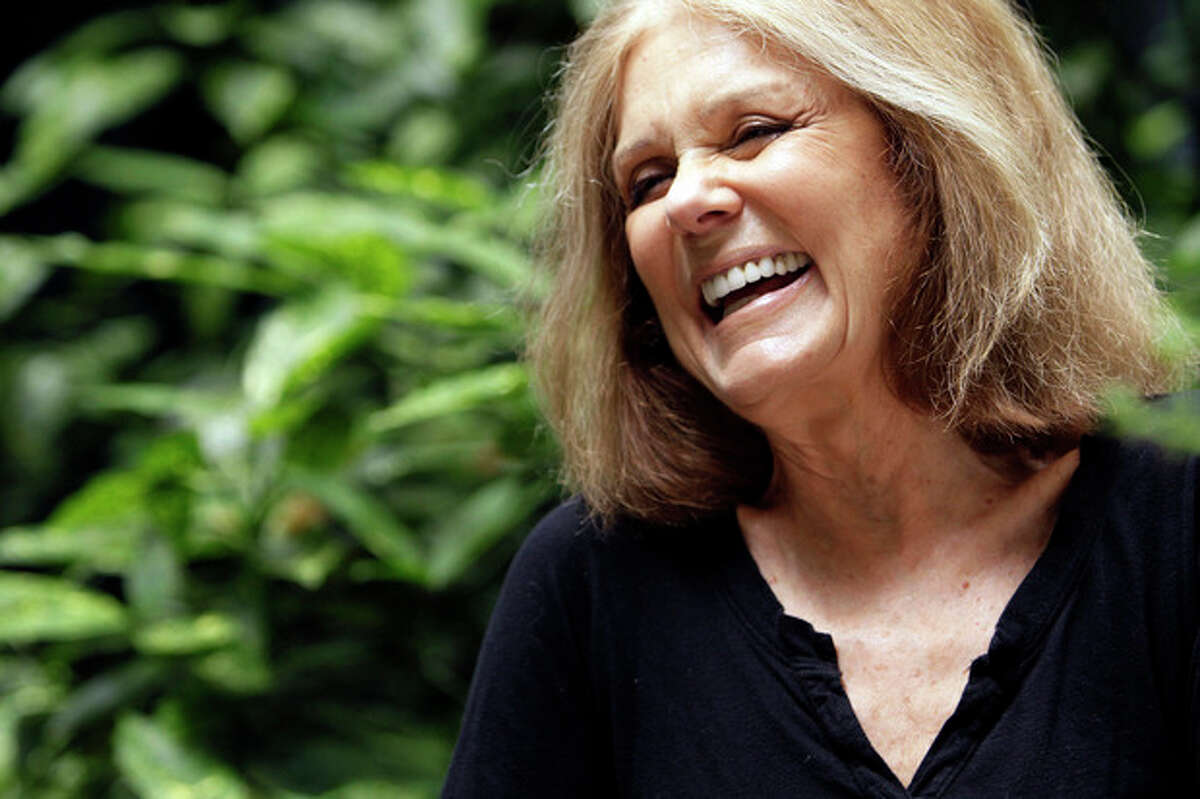 @White=[C] AP photo / Mary Altaffer In this Aug. 9 photo, Gloria Steinem laughs during an interview in New York. Four decades after she helped found the women's movement, the feminist icon is in a reflective mode, writing a memoir and participating in an HBO documentary on her life.