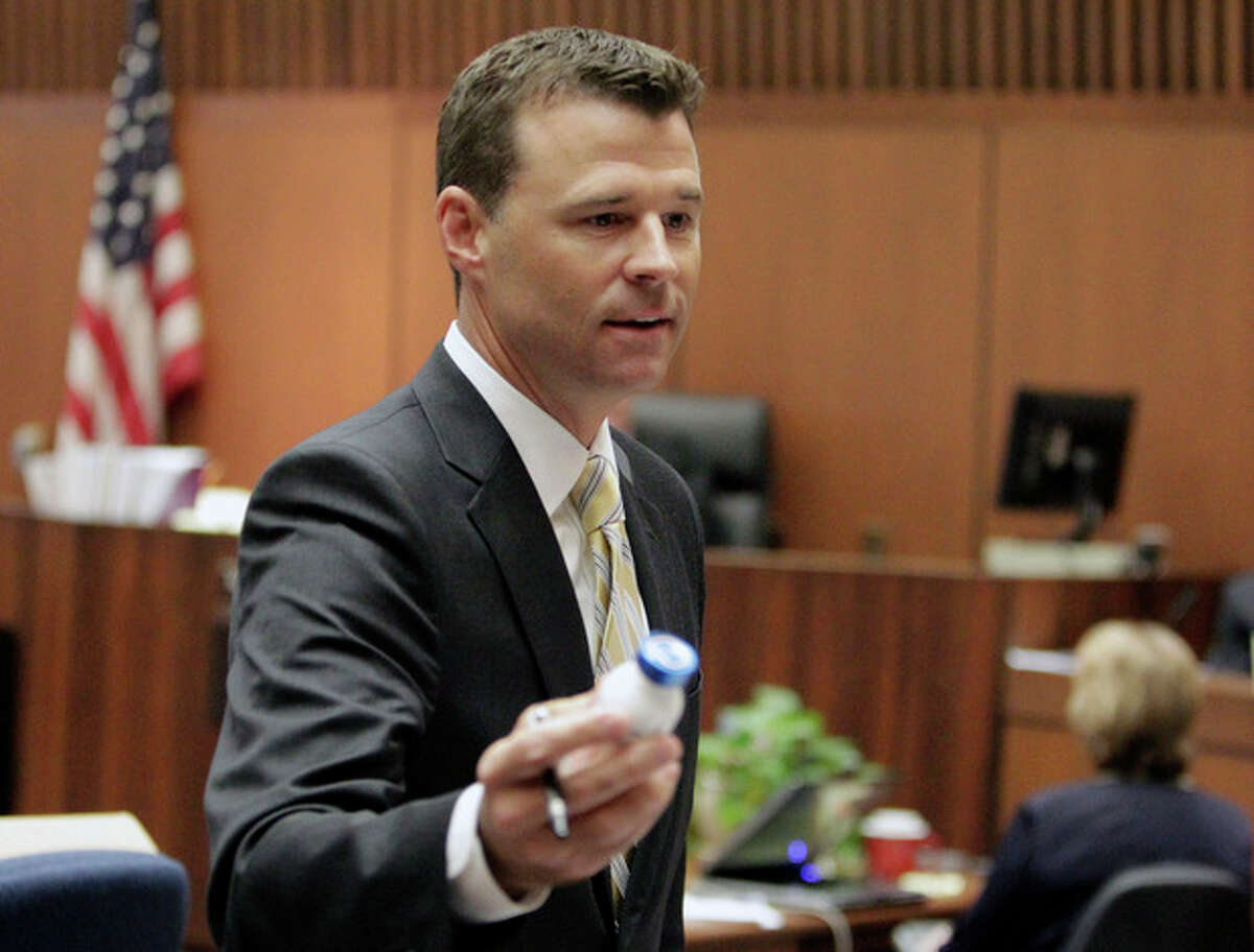 Deputy district attorney David Walgren holds a propofol bottle during Dr. Conrad Murray's involuntary manslaughter trial, Wednesday, Oct. 19, 2011, in downtown Los Angeles. Murray has pleaded not guilty and faces four years in prison and the loss of his medical license if convicted of involuntary manslaughter in Michael Jackson's death. (AP Photo/Reed Saxon, Pool)