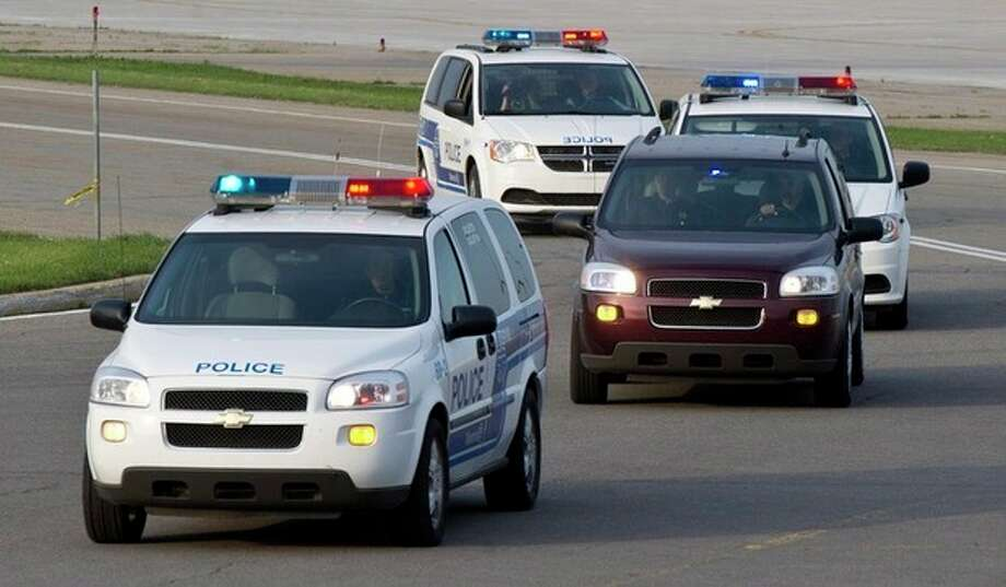A convoy of police vans leaves Mirabel airport carrying suspect Luka Rocco Magnotta on Monday, June 18, 2012, in Mirabel, Quebec. Magnotta, the suspect in the killing and dismemberment of a Chinese student is on his way back to Canada via military transport from Germany, where he was arrested this month. (AP Photo/The Canadian Press, Paul Chiasson) / The Canadian Press