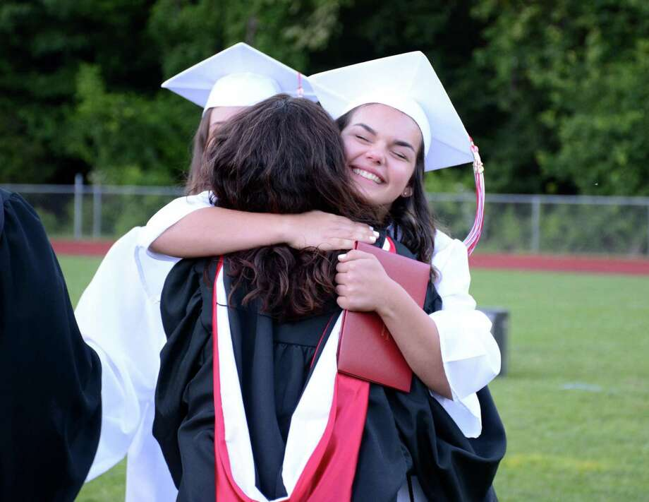 Lori Barcello gives a hug to a teacher after receiving her diploma during Masuk High School in Monroe, Connecticuts Commencement ceremony at their campus on Tuesday June 14, 2016. Photo: Lisa Weir, For Hearst Connecticut Media / The News-Times Freelance