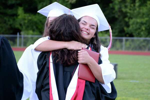 Lori Barcello gives a hug to a teacher after receiving her diploma during Masuk High School in Monroe, Connecticuts Commencement ceremony at their campus on Tuesday June 14, 2016.