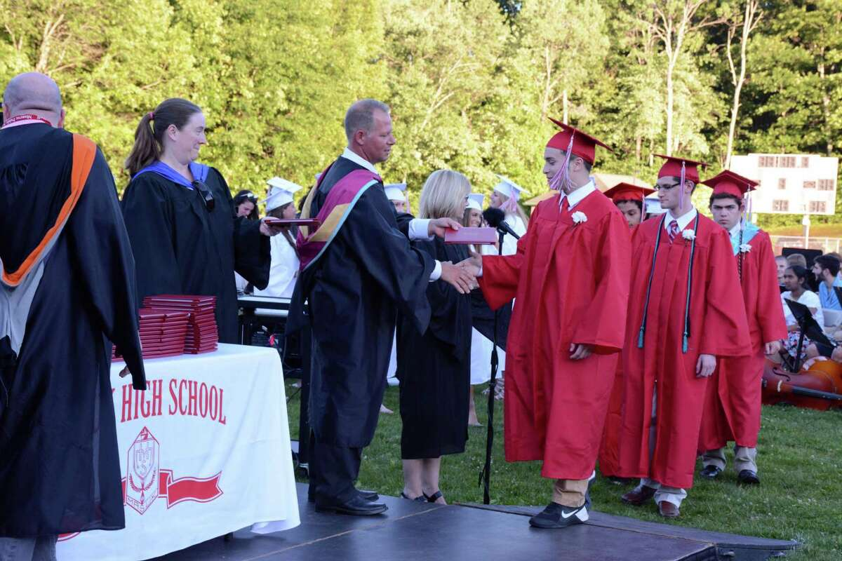 Charles DaVila recieves his diploma during Masuk High School in Monroe, Connecticuts Commencement ceremony at their campus on Tuesday June 14, 2016.