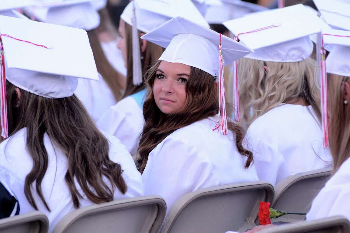 Samantha Roma looks back in search for family and friends during her graduation. Masuk High School in Monroe, Conn. held their Commencement ceremony at their campus on Tuesday June 14, 2016.
