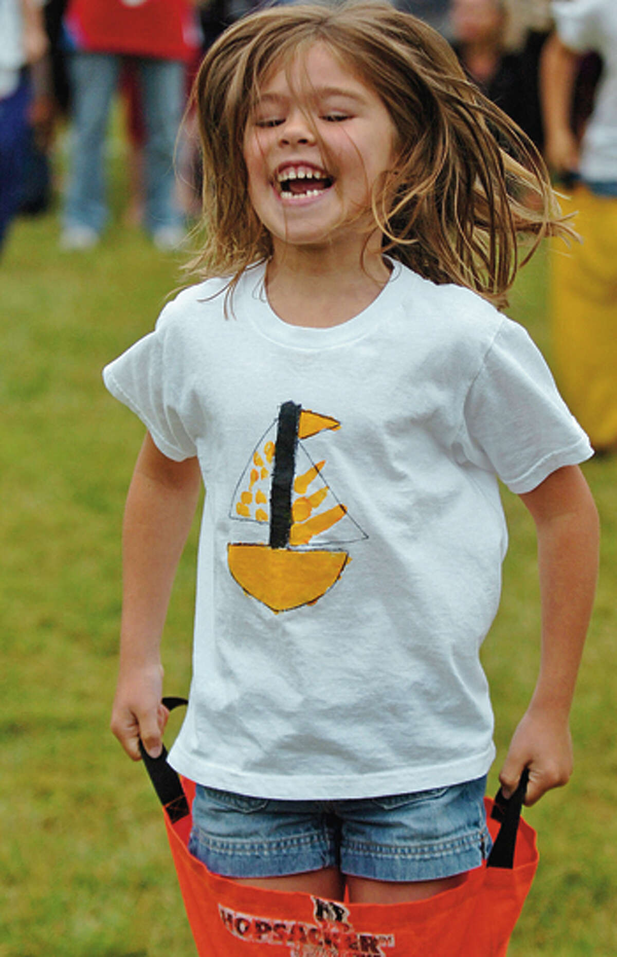 Miller Driscoll first grader Hannah Hemschot participates in the sack race during the school's field day Tuesday morning. Hour photo / Erik Trautmann