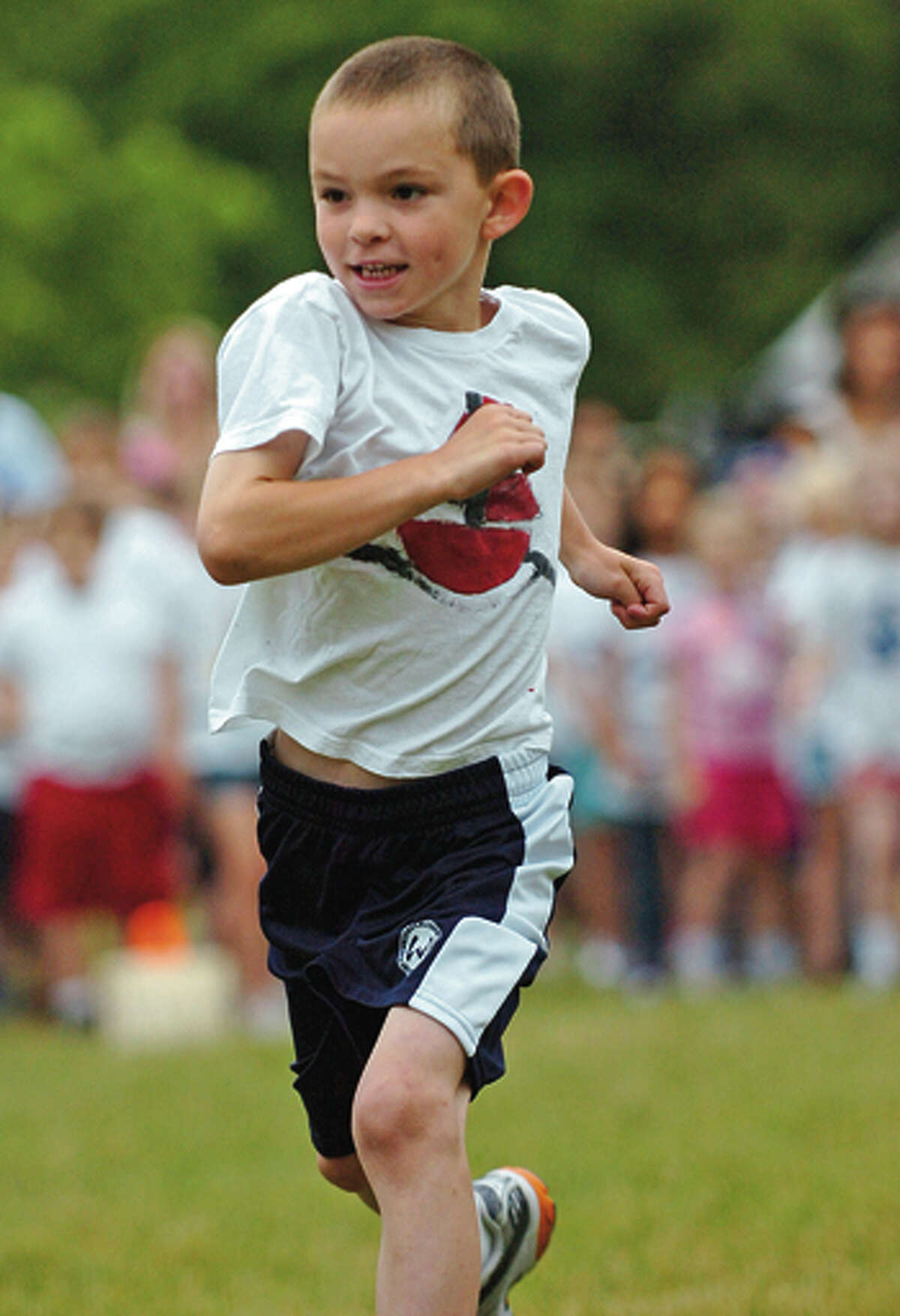 Miller Driscoll first grader Justin Lewis runs the dash during the school's field day Tuesday morning. Hour photo / Erik Trautmann