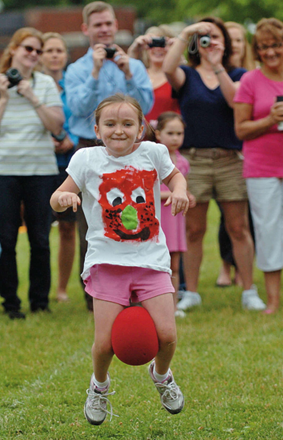 Miler Driscoll first grader Madison Locher partipates in the ball race during the Miller Driscoll School's field day Tuesday morning. Hour photo / Erik Trautmann