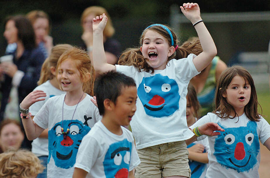 Miler Driscoll first grader Kathryn Vollmer celebrates after Ms. Senna's class won in the tug of war event during the Miller Driscoll School's field day Tuesday morning. Hour photo / Erik Trautmann / (C)2012, The Hour Newspapers, all rights reserved