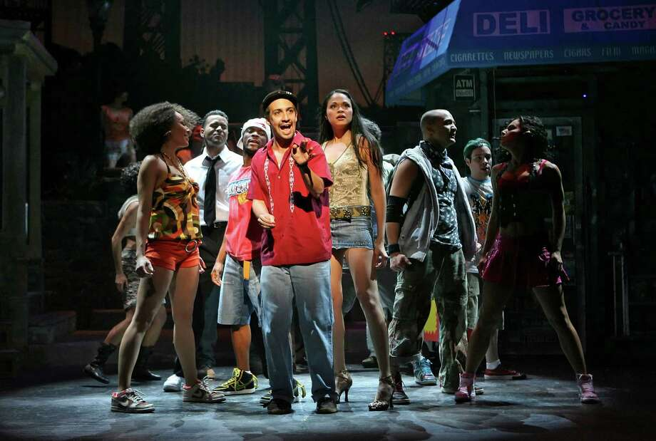 """FILE -- (NYT48) NEW YORK -- May 13, 2008 -- TONY-NOMINEES --Lin-Manuel Miranda, center, as Uanavi in the musical """"In the Heights"""" at the Richard Rodgers Theater in Manhattan, Feb. 13, 2008. """"In the Heights,"""" a rap, hip-hop and salsa flavored musical about Latino families in Washington Heights, led the Tony nominations, which were announced on Tuesday morning, May 13, 2008 with 13 nods, including two for Lin-Manuel Miranda, the show's 28-year-old creator and star. Photo: SARA KRULWICH, STF / sfc"""