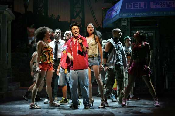 "FILE -- (NYT48) NEW YORK -- May 13, 2008 -- TONY-NOMINEES --Lin-Manuel Miranda, center, as Uanavi in the musical ""In the Heights"" at the Richard Rodgers Theater in Manhattan, Feb. 13, 2008. ""In the Heights,"" a rap, hip-hop and salsa flavored musical about Latino families in Washington Heights, led the Tony nominations, which were announced on Tuesday morning, May 13, 2008 with 13 nods, including two for Lin-Manuel Miranda, the show's 28-year-old creator and star."