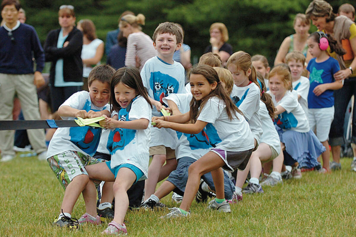 Ms. Sanna's first grade class particpates in the tug of war during the Miller Driscoll School's field day Tuesday morning. Hour photo / Erik Trautmann