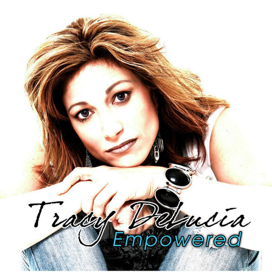 Contributed photo Singer-songwriter Tracy DeLucia poses on the cover of her new CD. DeLucia will perform Sunday at Calf Pasture Beach in Norwalk.