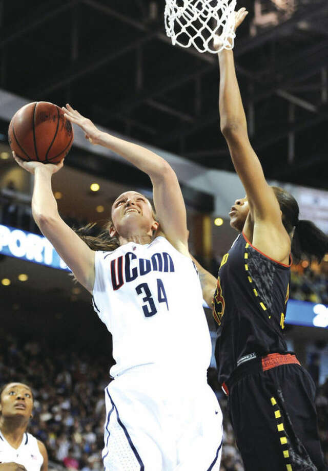 AP photoUConn's guard Kelly Faris, left, shoots against Maryland center Alicia DeVaughn during the first half of Saturday's NCAA Bridgeport Regional semifinal game at the Arena at Harbor Yard. UConn scored a 76-50 victory.