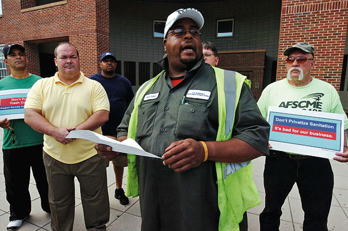 AFSME Local 2405 president Milton Giddeons and others who object to garbage privatization address the press and while protesting outside City Hall. Hour photo / Erik Trautmann