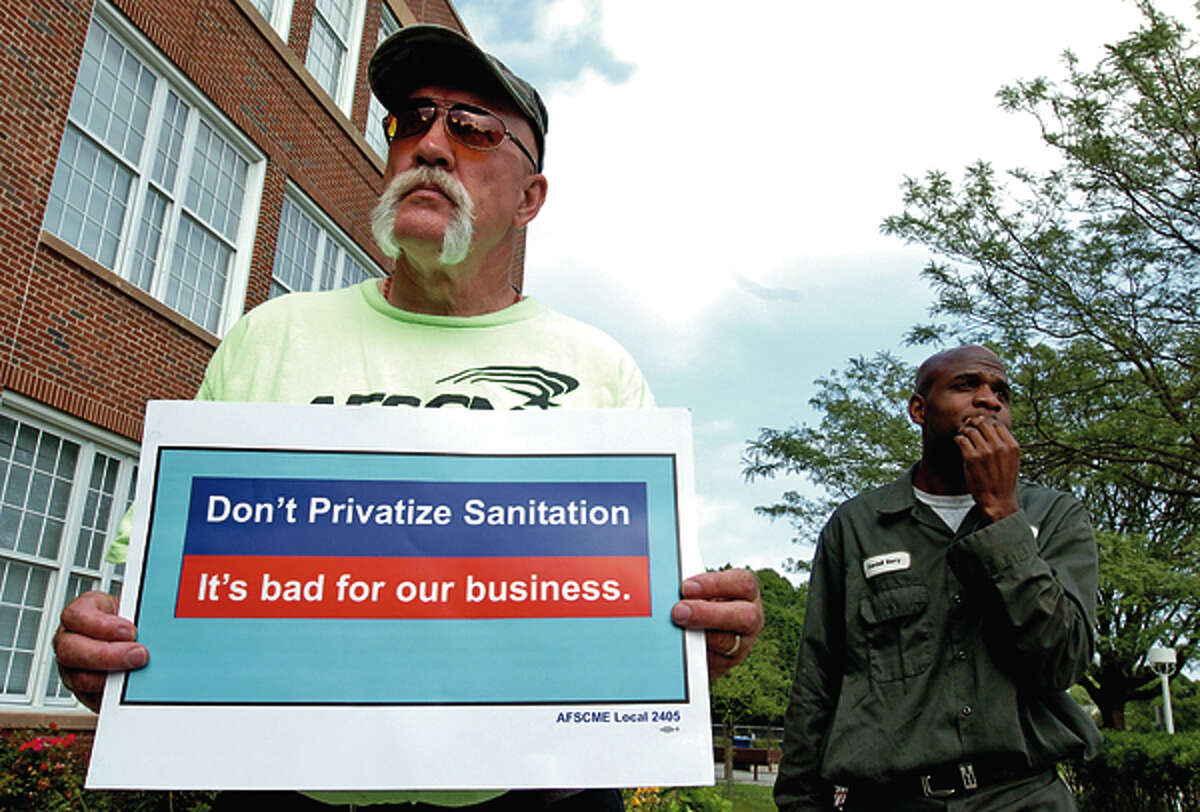 AFSME Local 2405 member Bela Garrison and others who object to garbage privatization gather to protest outside City Hall. Hour photo / Erik Trautmann
